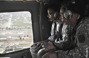 Barack Obama tours Iraq with Gen. David Petraeus in July, when he sought to stall any agreement for US troop withdrawal until President Bush left office. (Reuters photo)