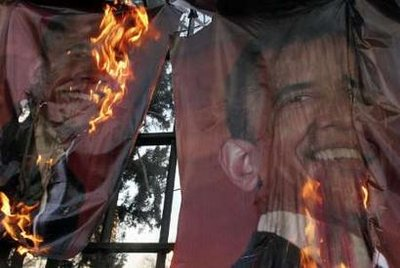 Hardline demonstrators burn posters of U.S. President-elect Barack Obama, during a demonstration in support of the people of Gaza, in front of the Swiss Embassy in Tehran January 13, 2009. (Reuters)