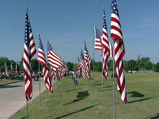 "The annual Veterans' ""Avenue of Flags"" at Floral Haven cemetery, Broken Arrow, Oklahoma   ---Source: KTUL.com"